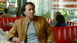 Yup, Nicholas Cage is at a dinner drinking a martini. Because why not?